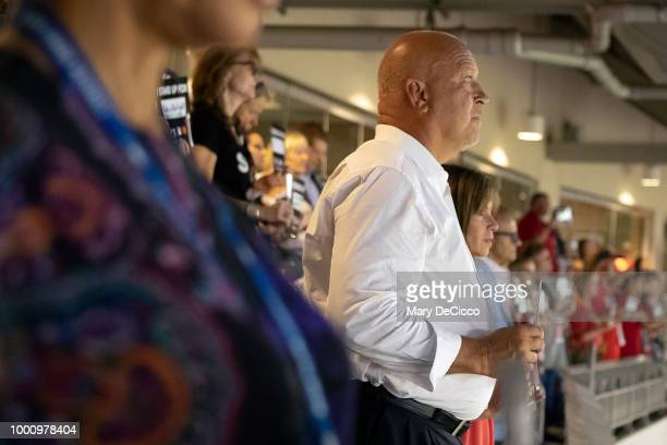 Former Baltimore Oriole Cal Ripken Jr is seen holding up a Stand Up 2 Cancer placard during the SU2C moment at the 89th MLB AllStar Game at Nationals...