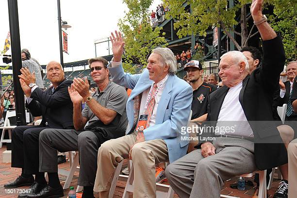 Former Baltimore Orioles Cal Ripken Jr.,Jim Palmer, Brooks Robinson and Earl Weaver attend the unveiling of Eddie Murray's bronze sculpture in the...