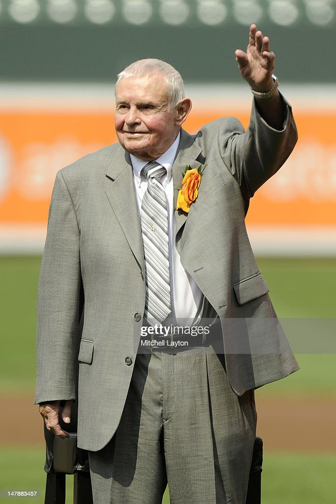 Former Baltimore Orioles manager Earl Weaver waves to the fans during the unveiling of his bronze sculpture in the Legends garden of a baseball game against the Baltimore Orioles at Oriole Park at Camden Yards on June 30, 2012 in Baltimore, Maryland. The Indians won 11-5.