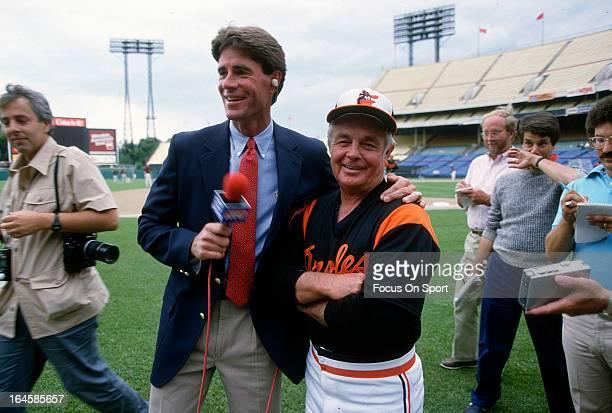 Former Baltimore Orioles pitcher Jim Palmer now with Orioles TV with Baltimore Orioles Manager Earl Weaver during batting practice before an Major...