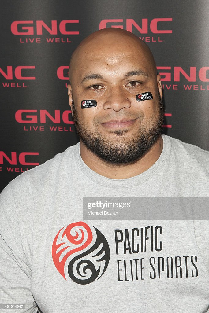 Former Baltimore Ravens player Maake Kemoeatu signs autographs at the Pacific Elite Sports Fitness Center Grand Opening on January 24, 2014 in Kaneohe, Hawaii.