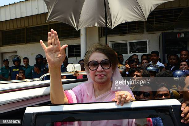 Former Bangladeshi prime minister and Bangladesh Nationalist Party leader Khaleda Zia waves as she leaves after a court appearance in Dhaka on June 2...