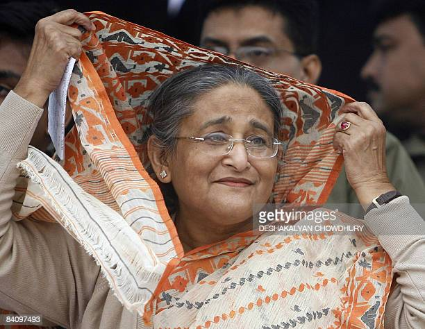 Former Bangladeshi prime minister and chief of the Awami League party Sheikh Hasina Wajed gestures as she attends an election campaign rally in Dhaka...