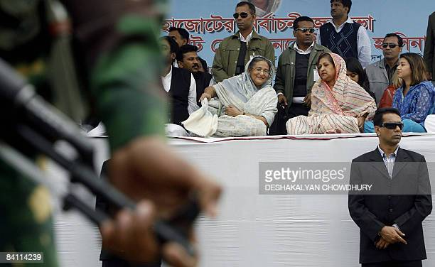 Former Bangladeshi prime minister and chief of the Awami League party Sheikh Hasina Wajed is surrounded by security guards during an election...