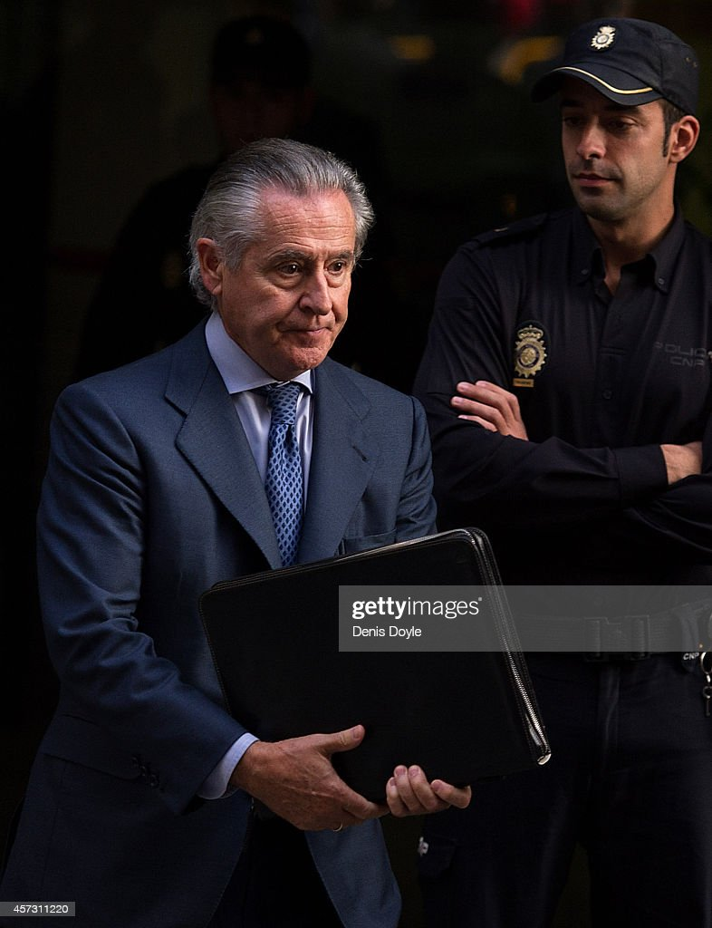 Former Bankia chief Miguel Blesa leaves Madrid's High Court where Rodrigo Rato, former chairman of rescued bank Bankia and former head of the International Monetary Fund is scheduled to answer allegations of misusing company credit cards on October 16, 2014 in Madrid Spain. Judge Fernando Andreu is questioning Rato along with former Bankia chief Miguel Blesa and former financial director Ildefonso Sanchez Barcoj.