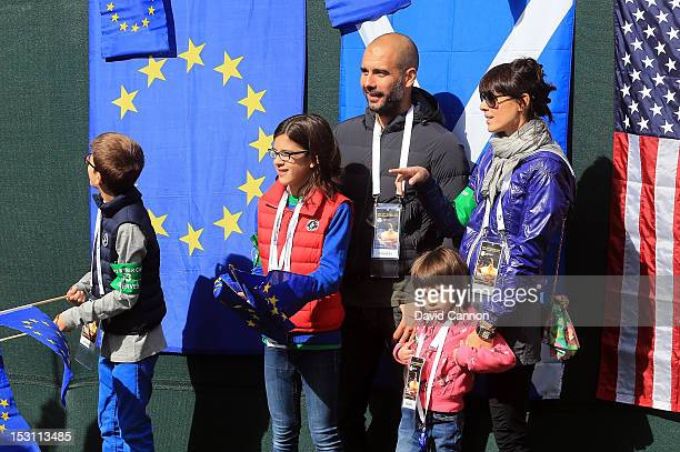 Former Barcelona football team manager Pep Guardiola and wife Cristina Serra and family stand behind the first tee box before the Singles Matches for...