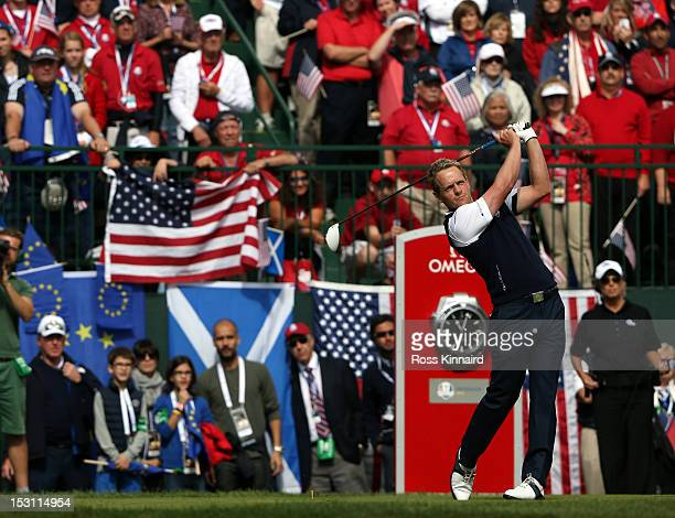 Former Barcelona football team manager Pep Guardiola and wife Cristina Serra and family watch as Luke Donald of Europe hits his tee shot on the first...