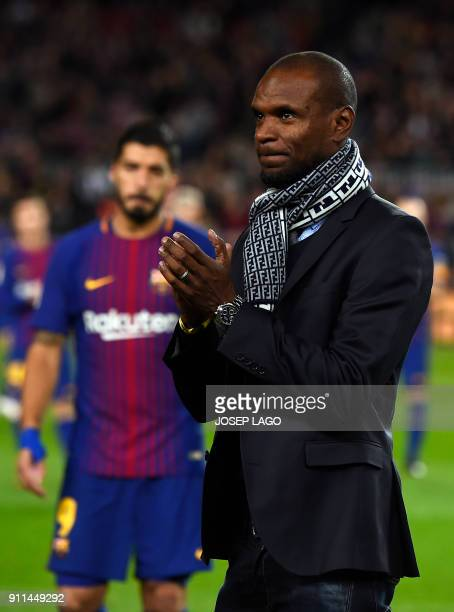 Former Barcelona French player Eric Abidal arrives to give the Best Player of the Month award to Barcelona's Uruguayan forward Luis Suarez before the...