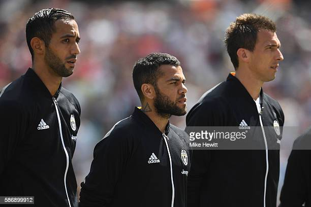 Former Barcelona player Dani Alves lines up with his new Juventus team mates ahead of the PreSeason Friendly between West Ham United and Juventus at...