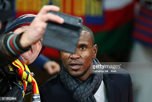 Former Barcelona player Eric Abidal has his photo taken with a fan before the UEFA Champions League match between Arsenal and Barcelona at the...