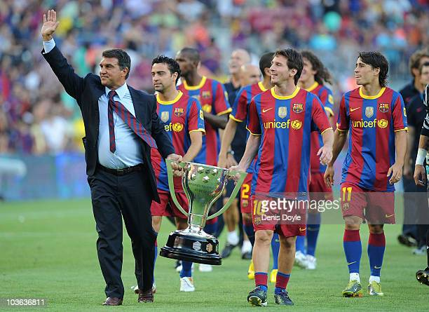 Former Barcelona president Joan Laparta holds the 2009-2010 La Liga trophy with Leo Messi during a lap of honour before the Joan Gamper Trophy match...