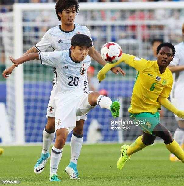 Former Barcelona youth player Takefusa Kubo vies for the ball with Meyiwa in Japan's 21 win over South Africa in their Under20 World Cup Group D...