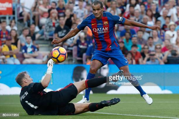 Former Barcelona's Brazilian midfielder Rivaldo vies with former Manchester's English goalkeeper Kevin Pilkington during a charity football match...