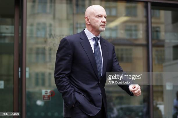 Former Barclays head of investment banking and investment management in the Middle East Roger Jenkins leaves after an appearance at Westminster...