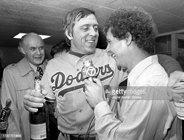 Former Baseball Commissioner Bowie Kuhn looks on as Rick Monday of the Los Angeles Dodgers is interviewed by former Los Angeles broadcaster Tony...