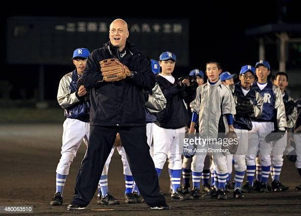 Former baseball player Cal Ripken instructs during the baseball lesson held with Sachio Kinugasa at the tsunami devastated area on November 10 2011...