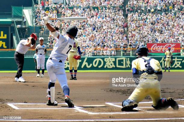 Former baseball player Hideki Matsui reacts after throwing the ceremonial first pitch prior to the Japanese High School Baseball Championship at...