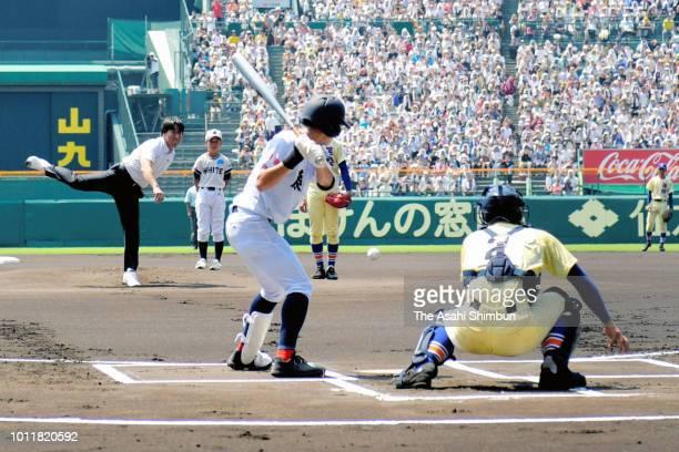 Former baseball player Hideki Matsui throws the ceremonial first pitch prior to the Japanese High School Baseball Championship at Hanshin Koshien...