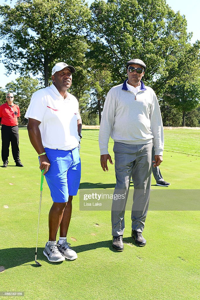 Former baseball player Joe Carter with Julius Erving at the Julius Erving Golf Classic at Aronimink Golf Club on September 14, 2015 in Newtown, Pennsylvania.