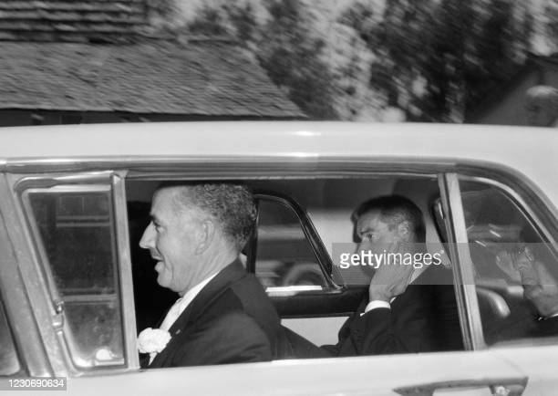 Former baseball player Joe Di Maggio leaves the cemetery during the funeral of US actress Marilyn Monroe in Los Angeles on August 8, 1962.