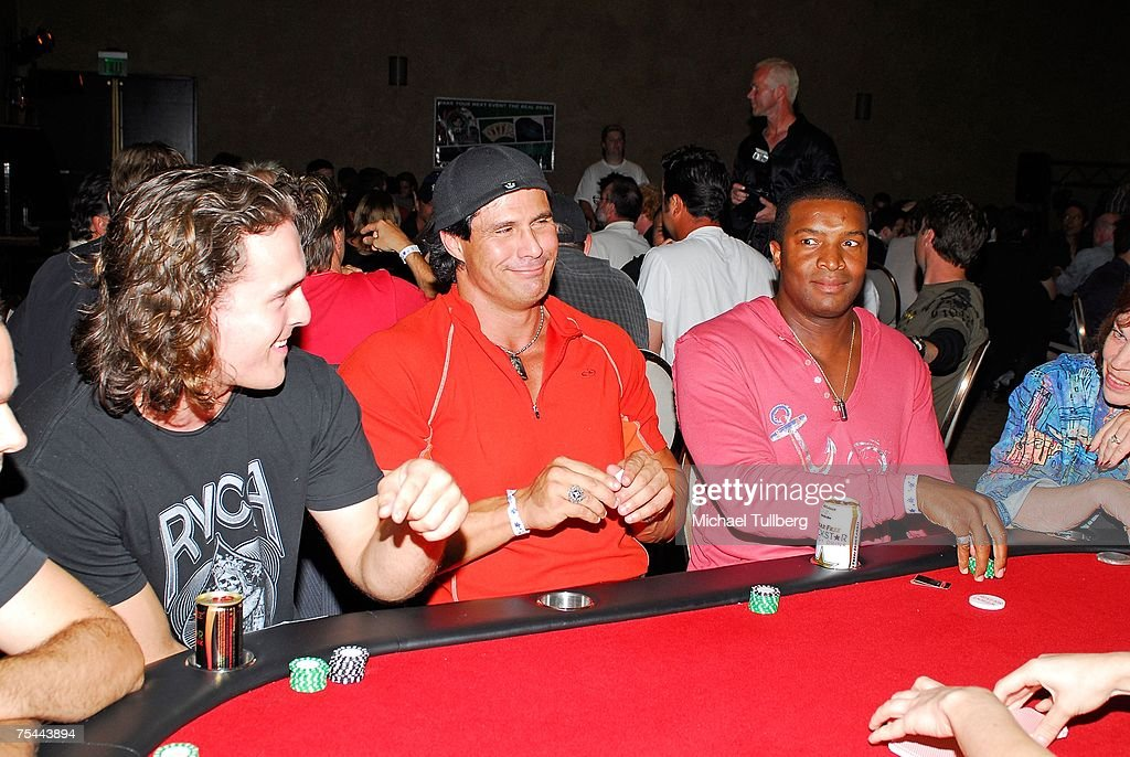 Former baseball player Jose Canseco (C) and actor Roger Cross (R) share a laugh at the poker table at The Clear View Treatment Center's Charity Texas Hold'Em celebrity poker tournament, held at the Roosevelt Hotel on July 16, 2007 in Los Angeles, California.