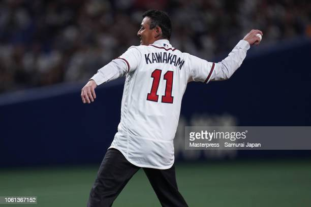 Former baseball player Kenshin Kawakami throws a ceremonial first pitch prior to the game five between Japan and MLB All Stars at Nagoya Dome on...