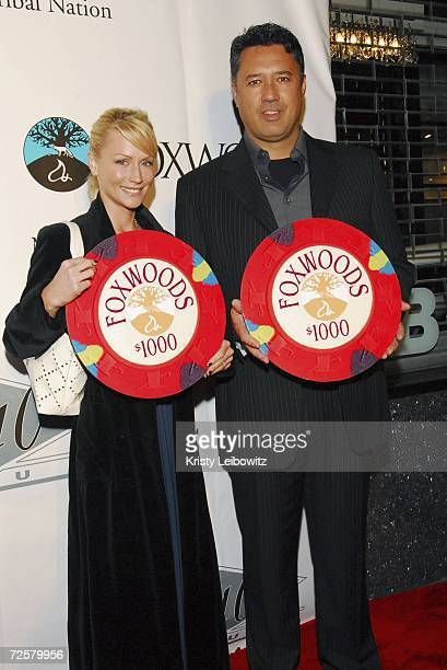 Former baseball player Ronald Darling and wife pose at the Charity Celebrity Poker Tournament hosted by Alex Rodrigues at JayZ's Club 40/40 on...