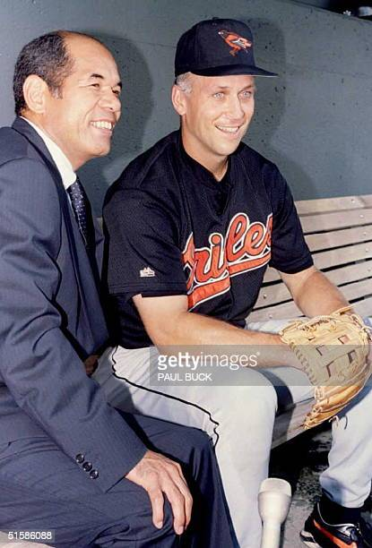 Former baseball player Sachio Kinugasa of Japan and Cal Ripken of the Baltimore Orioles pose for photographers before the Orioles meet the Kansas...