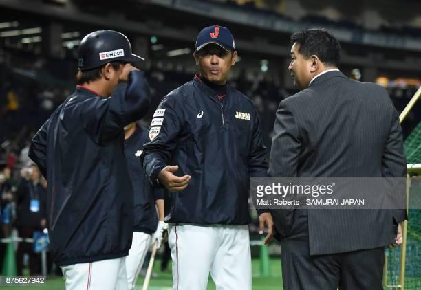 Former baseball player Tsutomu Ito Head coach Atsunori Inaba and Catcher Tatsuhiro Tamura of Japan talk prior to the Eneos Asia Professional Baseball...