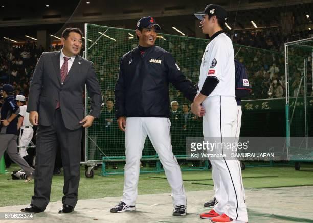 Former baseball player Tsutomu Ito Head coach Atsunori Inaba of Japan and Outfielder Yang DaiKang of Chinese Taipei talk prior to the Eneos Asia...