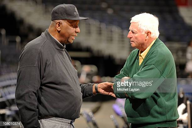 Former basketball coach John Thompson Jr and ESPN announcer Bobby Knight talk before a college basketball game between the Georgetown Hoyas and the...