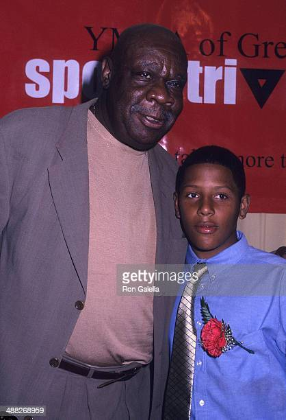 Former basketball player Cal Ramsey and YMCA kid attend the YMCA of Greater New York's First Annual Sports Triangle Dinner on July 8 2002 at The...