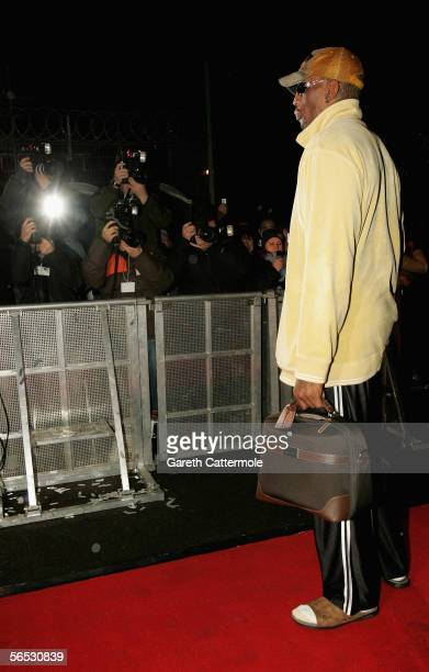Former basketball player Dennis Rodman poses for photographers as he enters the new Celebrity Big Brother house for the new series of the reality TV...