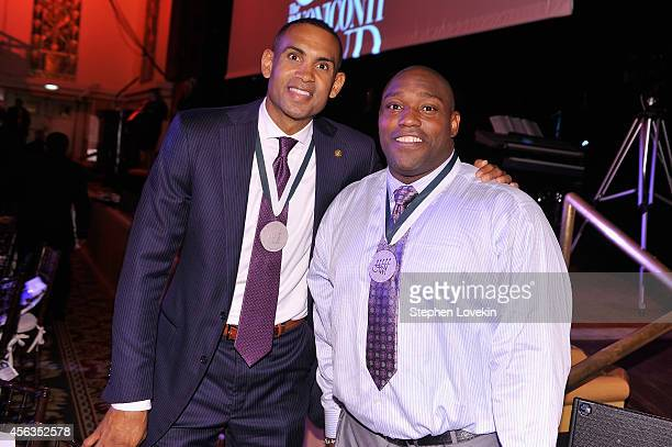 Former basketball player Grant Hill and former football player Warren Sapp attend the 29th Annual Great Sports Legends Dinner to benefit The...
