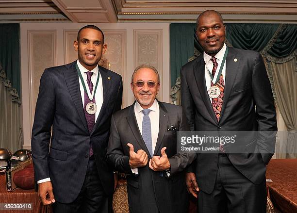 Former basketball player Grant Hill musician Emilio Estefan and former basketball player Hakeem Olajuwon attend the 29th Annual Great Sports Legends...