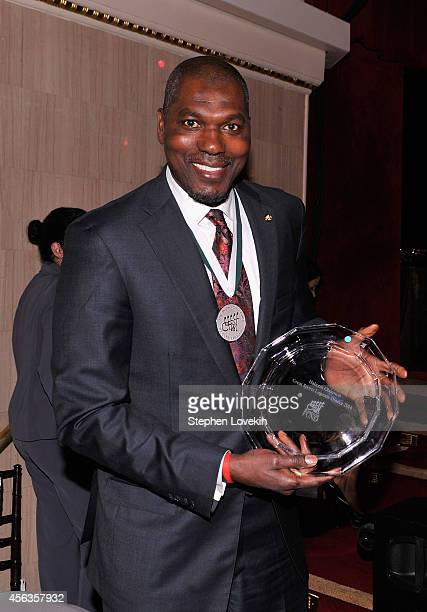 Former basketball player Hakeem Olajuwon poses at the 29th Annual Great Sports Legends Dinner to benefit The Buoniconti Fund to Cure Paralysis at The...