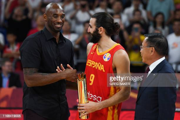 Former basketball player Kobe Bryant of the US presents Spain's Ricky Rubio the man of the match trophy at the end of the Basketball World Cup final...