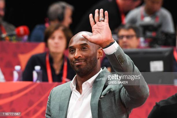 Former basketball player Kobe Bryant of the US waves at the crowd during the Basketball World Cup semifinal game between Australia and Spain in...