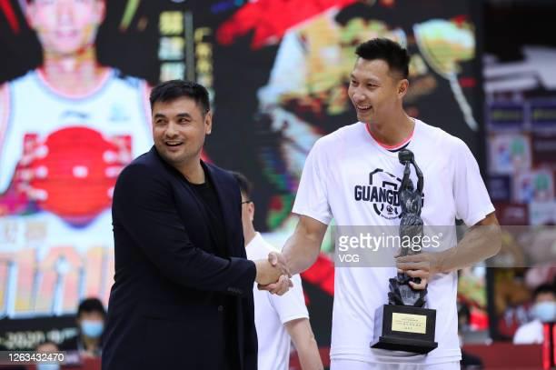 Former basketball player Liu Yudong shakes hands with Yi Jianlian of Guangdong Southern Tigers ahead of 2019/2020 Chinese Basketball Association...