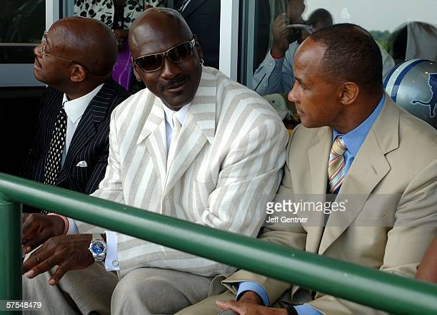 Former basketball player Michael Jordan and Former Pittsburgh Steeler and NFL Hall of Famer Lynn Swann talk in the Jockey Club at the 132nd Kentucky...