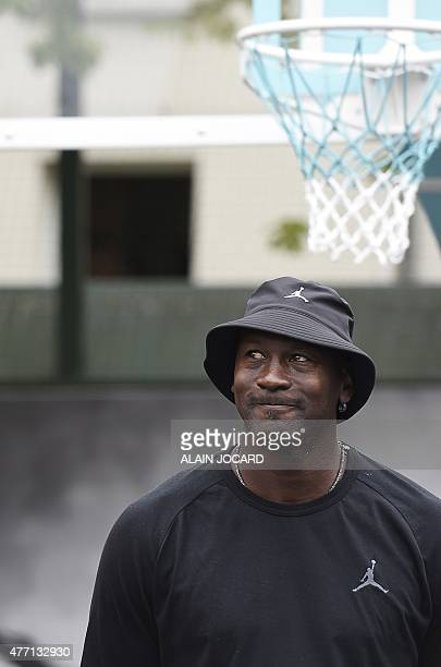 US former basketball player Michael Jordan looks on as he attends the inauguration of a street basketball court in the Haies sports ground in Paris...