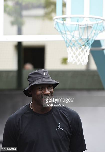 Former basketball player Michael Jordan looks on as he attends the inauguration of a street basketball court in the Haies sports ground in Paris on...