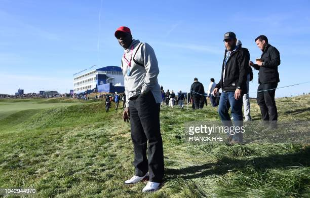 US former basketball player Michael Jordan watches US golfer Tiger Woods' foursomes match on the second day of the 42nd Ryder Cup at Le Golf National...