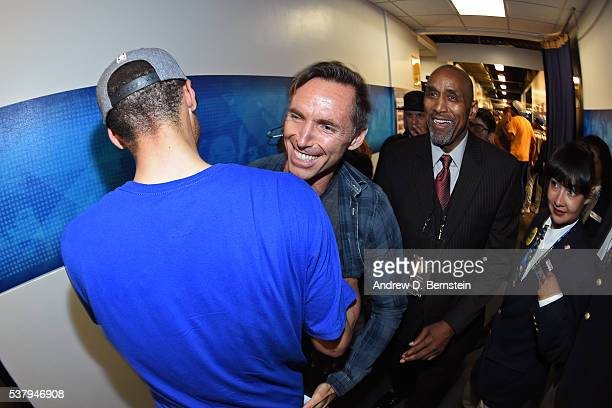 Former basketball player Steve Nash shares a hug with Stephen Curry of the Golden State Warriors after the game against the Oklahoma City Thunder...