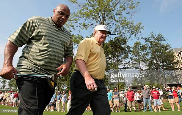 Former basketball star Charles Barkley walks off the first tee with Andy Bean during the Thursday ProAM of the Regions Charity Classic at the Robert...