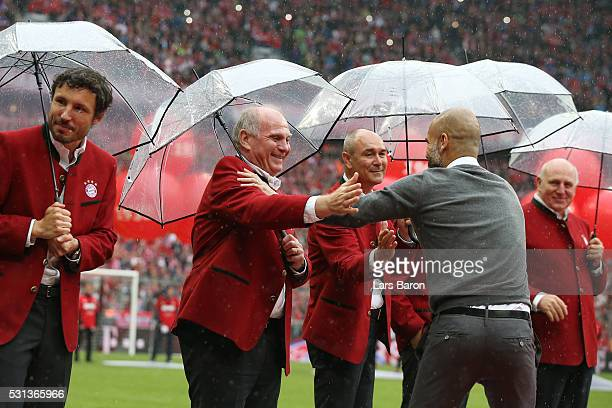Former Bayern Muenchen President Uli Hoeness congratulates Josep Guardiola coach of Bayern Muenchen after the Bundesliga match between FC Bayern...