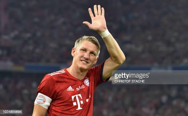 Former Bayern Munich's midfielder Bastian Schweinsteiger waves during he come for the second time of his farewell match for Bastian Schweinsteiger...