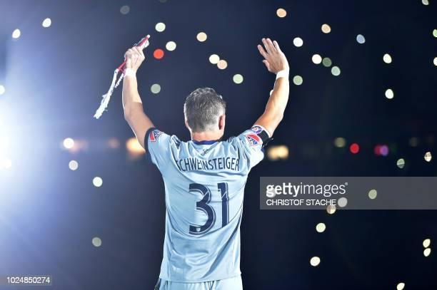Former Bayern Munich's midfielder Bastian Schweinsteiger waves prior the farewell match for Bastian Schweinsteiger between his former teams FC Bayern...