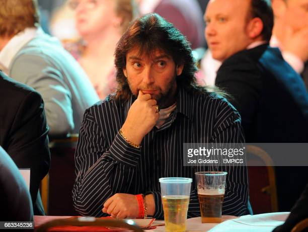 Former BDO world champion Andy Fordham watches the darts