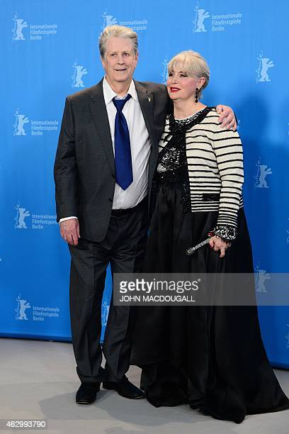 Former Beach Boy Brian Wilson and his wife Melinda Ledbetter pose for photographers during the photocall for the film Love Mercy presented in the...